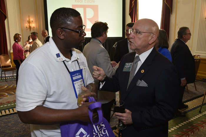 Two CIPS designees networking