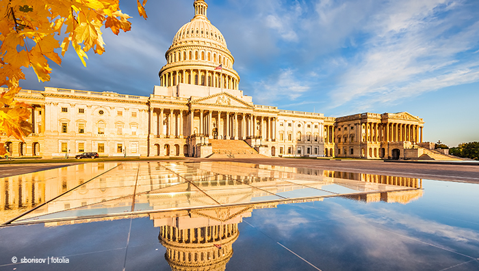 The U.S. Capitol, reflected in the roof of the visitors' center.
