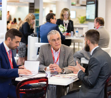 A member from Illinois getting down to business in the NAR-USA Pavilion's meeting space.
