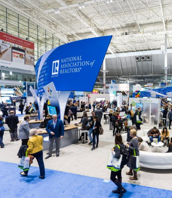 Wide image of the 2018 REALTORS® Expo floor with booths and REALTOR® Merchandise