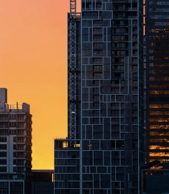 Commercial buildings at sunset