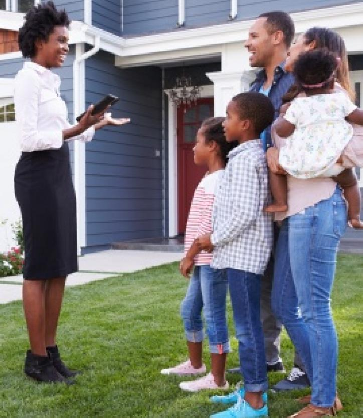 REALTOR® Talking to Family Outside Home