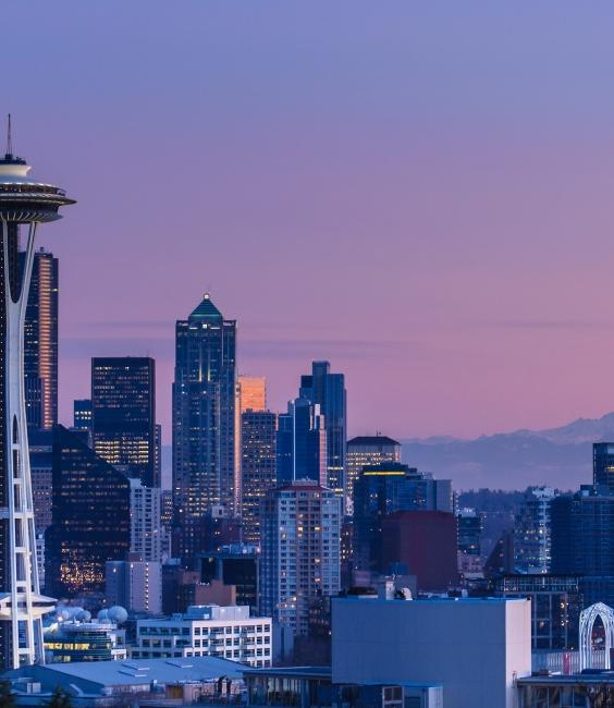 View of downtown Seattle at dusk with a purple hue color