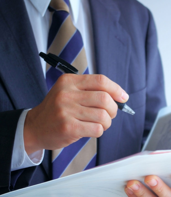 Man in Suit With Pen