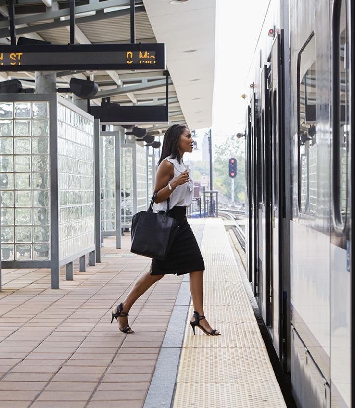 Woman boarding public transit train