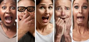 Several faces showing fearful or shocked expressions