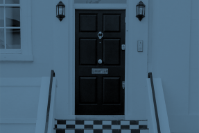 Blue-tinted photo of an exterior door at the top of some steps