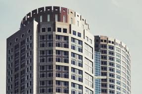Commercial buildings featuring two towers with round facades