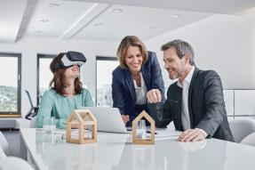 Business meeting with VR glasses and architectural models