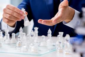 Businessman playing chess in office