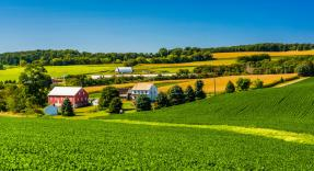 View of farm land and houses in rural York County, Pennsylvania.