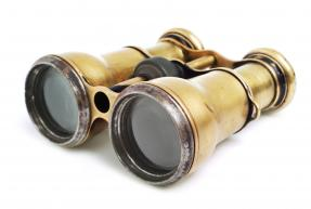 old binoculars facing left