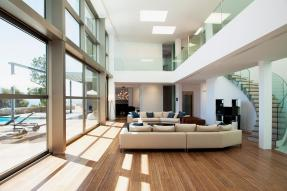 Modern Home With Sofas, Glass, and Pool