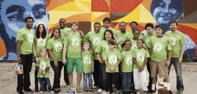 Group of volunteers in matching green shirts