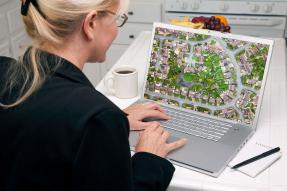 Woman Looking at Street Plan