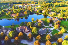 Aerial view of a residential area with a lake