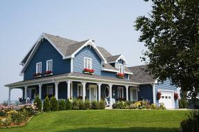 Blue house with wrap-around porch