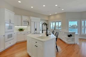 White cabinets with kitchen island