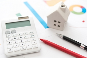 calculator-graphs-pens-ceramic-house-GettyImages-639884086-1300w-868h.jpg