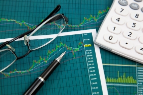 Charts, a calculator, a pen, and glasses