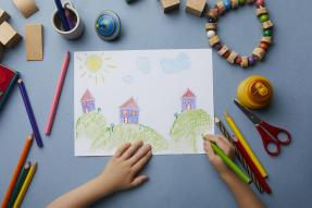 Child drawing picture of houses