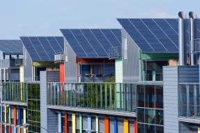 Colorful building with rooftop solar panels