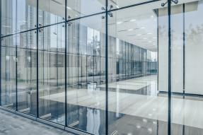Commercial building corridor seen through glass walls