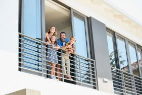 Condo - Family of Four on Balcony