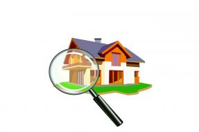 Drawing of a house under a magnifying glass