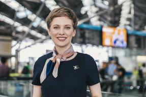 Female flight attendant in an airport