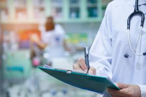 Doctor Writing a Prescription in a Hospital