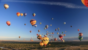 Hot Air Balloons over Landscape