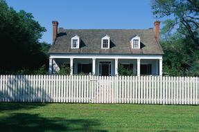 House behind a white picket fence
