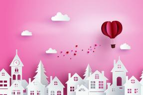 Illustration of hot air balloon sprinkling hearts over a town