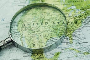 Magnifying glass and map of USA