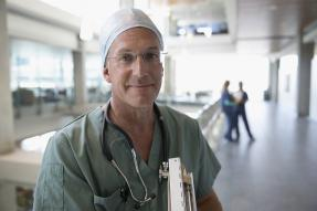 Medical professional wearing scrubs and a stethoscope