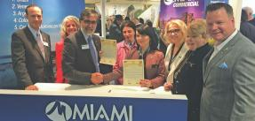 Miami REALTORS® at their booth at MIPIM 2019