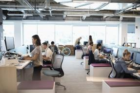 People working in an open office plan
