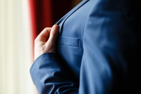 Person holding a suit lapel