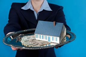 Person offering keys, money, and a house on a silver platter