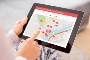 Real estate mapping website on a tablet computer.