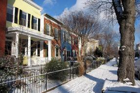 Row houses on a snowy street