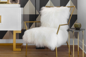 Sheepskin hairy chair with gold colored frame