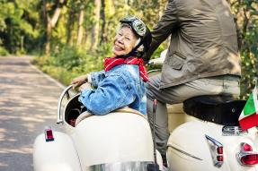 Smiling senior woman in a sidecar
