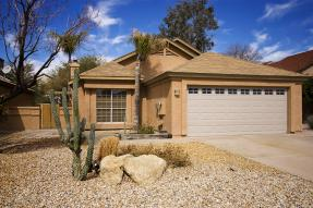 Southwestern home with cactus and blue sky
