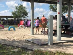 Melbourne, FL dog park - covered area with sand pit, tire toys