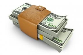 Stack of hundred dollar bills in a wallet