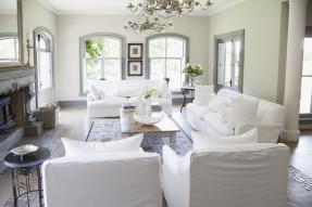 Staged living room with white slipcovers on furniture