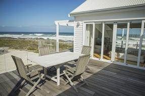 Table and chairs on beach house deck