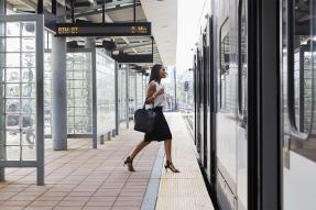Woman boarding public transit train